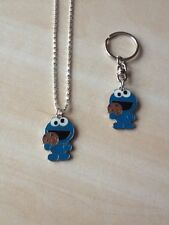 1 silver tone sesame st cookie monster necklace and matching keyring gift set
