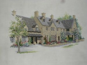 Completed cross stitch embroidery of houses
