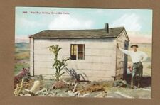"""""""out West"""" Wife Wanted, Holding down the claim. man leans on nice claim shack"""