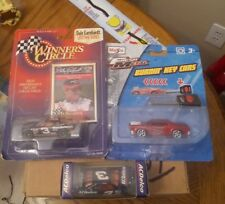 THREE DIECAST COLLECTABLE RACING CARS