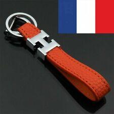 porte-clés cuir orange homme femme motif H conception du luxe Hermès