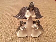 "St. Nicholas Square ""Angel with Children Angels� Statue"