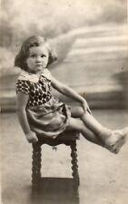 Vintage Photo Postcard Girl Sat on Small Table (18FAM)