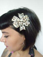 Pince clip cheveux noeud léopard beige marron coiffure rétro pinup rockabilly