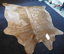 RIPPLES OF SALTED CARAMEL THROUGH HONEYCOMB ICE-CREAM - A WONDERFUL COWHIDE RUG