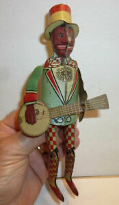 Strauss Jazzbo Jim banjo player jigger, good condition, for parts or restoration