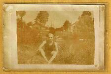 Carte Photo vintage card RPPC Homme cigarette assis au bord d'un fleuve ph022