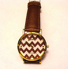 GENEVA PLATINUM BROWN  LEATHER BAND BROWN  ZIGZAG  DIAL FACE GOLD BEZEL WATCH