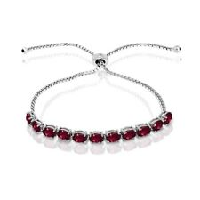 Oval-cut 6x4mm Created Ruby Adjustable Tennis Bracelet in Sterling Silver