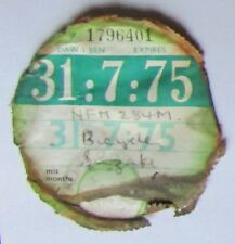 A SUZUKI MOTORCYCLE TAX DISC FROM JULY 31st 1975 ENGLISH AND WELSH TRANSLATIONS