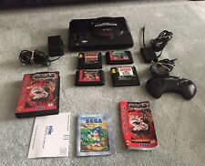 Sega Genesis 16 bit video game console with 4 games