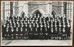 VINTAGE RPPC GROUP PORTRAIT OF ROYAL NAVY SAILORS AND OFFICERS CHURCH BACKGROUND
