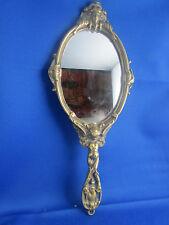 ancien miroir face a main en bronze doré style louis XV angelot