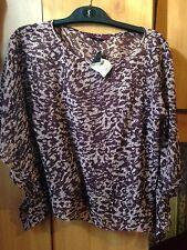 Next, purple top, size 8, casual wear