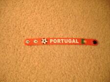 1)PORTUGAL  SILICONE  WRIST BAND  (NEW )