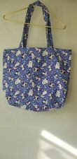 Ladies beach bag colored purples with puppies on it