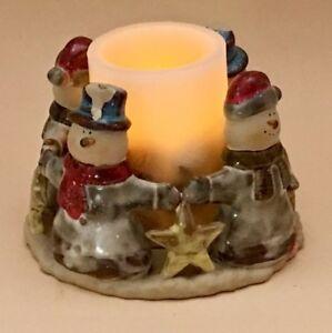 Charming Ceramic Snowmen and Stars Pillar Candle Holder