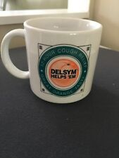 Vintage Delsym Helps 'Em Coffee Mug. Cough Syrup with logo on front and back!