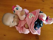 Used berenguer baby doll with toy