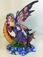 91407 Fairy Sitting On Moon Collectible Figurine by Backwoods Lighting LLC