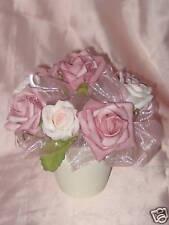 Artificial floral arrangement in a hand-painted pot