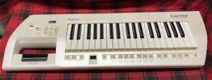 Roland Lucina AX-09 Keyboard Synthesizer Keytar White