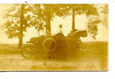 Girl Sits in Old Fashioned Auto-First Car-RPPC-Real Photo Vintage Postcard