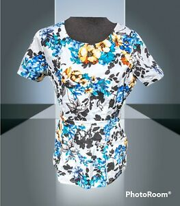 Jaanuu Women's Tulip Style Floral Scrub Top Sz S White fitted Retired Pattern