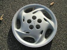 one 1995 to 1998 Pontiac Sunfire Grand AM 15 inch hubcap wheel cover