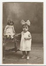 AN ADORABLE LITTLE GIRL AND HER SPOOKY DOLL IN BARCELONA, SPAIN (VINTAGE PHOTO)