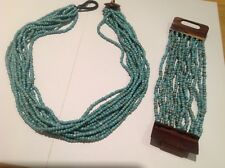 Multi strand beaded necklace with matching bracelet. Turquoise colour.