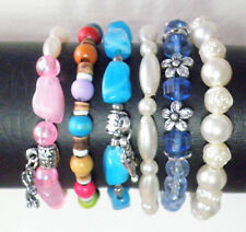 Stretch stacking bracelets a set of six in multi shape and colour beads