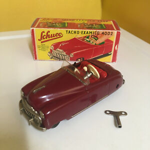 SCHUCO VINTAGE TIN CLOCKWORK TACHO-EXAMICO 4002 IN RED. WORKING IN REPRO BOX!
