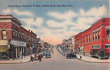 North Dakota postcard Bismarck Fourth Street north from Main Ave street scene