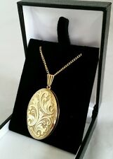 A 9ct Yellow Gold oval locket.Suspended on a 9ct gold chain.By George Jensen Ltd