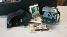 Film and accs plus a Polaroid One Step Express Camera