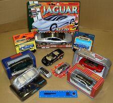 10 x JAGUAR XJ220 – various models & scales – Matchbox, Maisto, Edocar, Welly. A