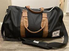 Herschel Supply Co Novel Duffle Bag In Black Tan MSRP $90