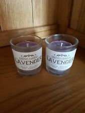 Lavender scented votive candle in a glass holder