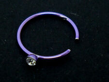 A CUTE LITTLE PURPLE COLOUR NOSE RING. NEW.