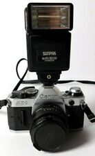 Canon AE-1 Camera with Riffen 52mm Sky 1-A Lens and Sunpak aouto30DX Thyristor F