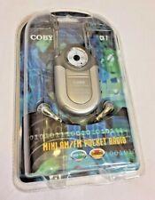 New Coby CX-7 Mini AM FM Pocket Radio DBBS Earphones Silver Neck Strap Music NIP