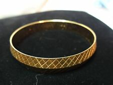 "vintage Monet gold tone etched bracelet approx. 7 3/4"" I.D. by 7/16"" width"