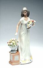 NADAL Fine Porcelain Figurine - FRESHENING THE FLOWERS  CG-96646