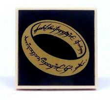 LEGO - Tile 2 x 2 with LotR Gold Ring on Black Background Pattern - Tan