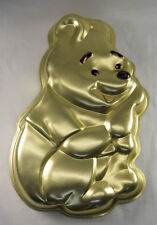 Winnie the Pooh Cake Pan with gold color on back of pan from Wilton #401