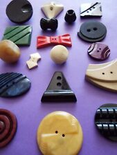 18 old/vintage Art deco (or similar) buttons in a colourful mix of designs