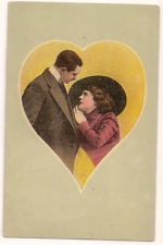 Antique postcard Victorian couple framed in heart romance valentine
