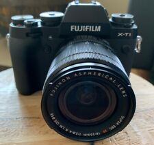 Fujifilm X-T1 with 18-55 lens, flash and 3 batteries
