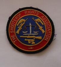 ORIGINAL - THE SHOOTERS RIGHTS ASSOCIATION INSIGNIA BULLION BADGE